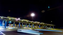4K highway night, big toll station, cars passing through timelapse Stock Footage