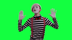 The mime is behind an invisible wall Stock Footage
