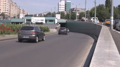 Back view of car traffic, vehicles moving in underpass passage, summer season  Stock Footage