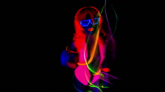 Ultra violet disco glow sexy gogo female dancer raver Stock Footage