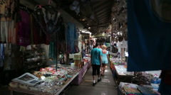 Tourist walking through market Stock Footage