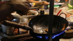 Outside food stall fry wok Thai Stock Footage
