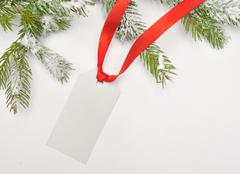 christmas greetings, invitation, snow-covered tree - stock photo