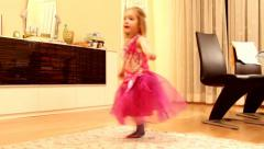 Little cute blond girl dancing in a new carnival dress Stock Footage