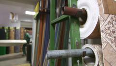 Rolls of linoleum and carpets in flooring warehouse Stock Footage