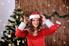 Young miss santa blowing snow Stock Photos