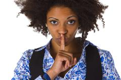 Stock Photo of Young afro american saying shhh