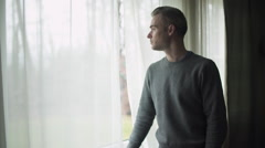 Depressed Man at Window (2 of 9) Stock Footage