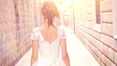 Stock Video Footage of Beautiful Young Bride Walking Through Medieval Town Dun Flare Purity Fantasy