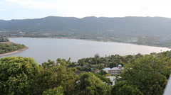 Overview lake and ocean scenic pan Thailand Stock Footage