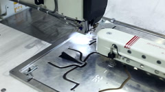 Sewing machine stitching on metal patterns Stock Footage