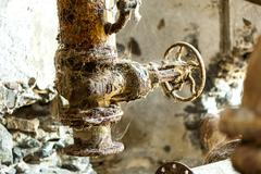 rusty machine in old rotten refinery station - stock photo