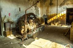 Rusty machine in old rotten refinery station Stock Photos