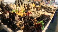 Statues small market stall tourist souvenir  Stock Footage