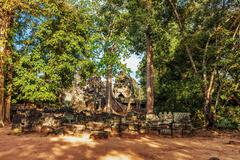 Ancient buddhist khmer temple in angkor wat complex, cambodia Stock Photos