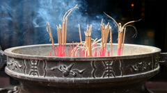 Incense Sticks Burning in Giant Pot in Front of Buddhist Temple Stock Footage