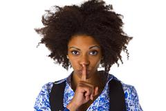 Young afro american saying shhh Stock Photos