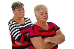 Two female seniors in dispute Stock Photos