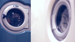 Washing machines in public laundry room with rotating drums Stock Footage