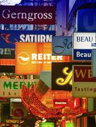 vienna - february 2, 2010: neon signs in city center. the city attracts more  - stock photo
