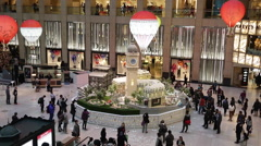 Time Lapse of customers walking around Christmas decorations at a shopping mall Stock Footage