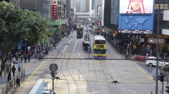 Time Lapse of buses and pedestrians go through a crossing at a street Stock Footage