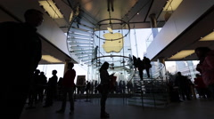 Time Lapse of customers walking on the spiral stairs at an Apple store - stock footage