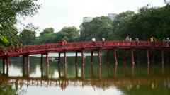 People Walking over The Huc Bridge on Hoan Kiem Lake - Hanoi Vietnam Stock Footage