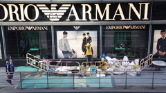 Labouers work next to the show window of ARMANI Stock Footage
