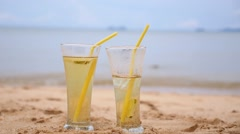 Couple with Fresh Drinks on the Beach. - stock footage