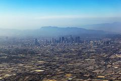 aerial of los angeles in fog - stock photo