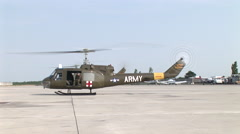 Huey helicopters take off from airport Stock Footage