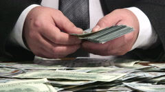 Business person counting bundle of US 100 dollars bank notes Stock Footage