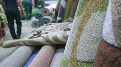 Carpets and rugs in store staff serving customers Stock Footage