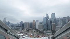 View of buildings of Hong Kong Central from a turning Ferris wheel Stock Footage