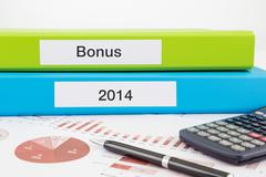 bonus documents with year reports - stock photo