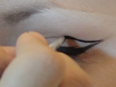 Applying a shadow on the upper eyelid - stock footage