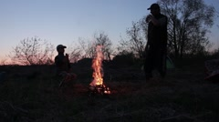 evening, fire, father and son.mp4 - stock footage