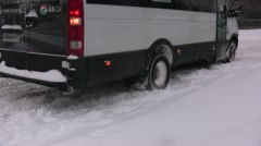 Blizzard in Russia. The minibus slips in snow. - stock footage