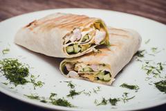 Chicken and avocado fried wrap Stock Photos