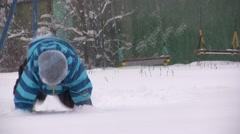 A Little Boy Plaing  on Snow Stock Footage