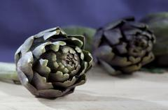 Artichoke on a purple background Stock Photos