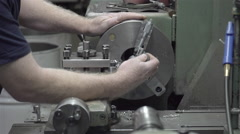 Machine shop worker slo mo Stock Footage