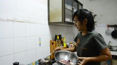Thai woman cooking Octopus and Squid boiled Stock Footage
