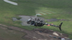 Kiowa OH-58 helicopter as seen from above Stock Footage