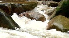 Mountain river full of crystal water. Slipper big stones and foamy chilly water - stock footage