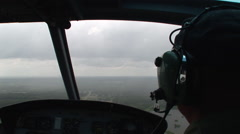 Huey helicopter flies into a rain storm Stock Footage