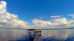 Time Lapse of clouds over a dock on a Lake No.2 Stock Footage