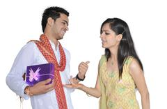 On Rakshabandhan, brother is teasing his sister, who is asking for her gift. Stock Photos