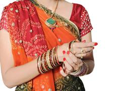 Indian girl getting ready for occasion and wearing bangles. Stock Photos